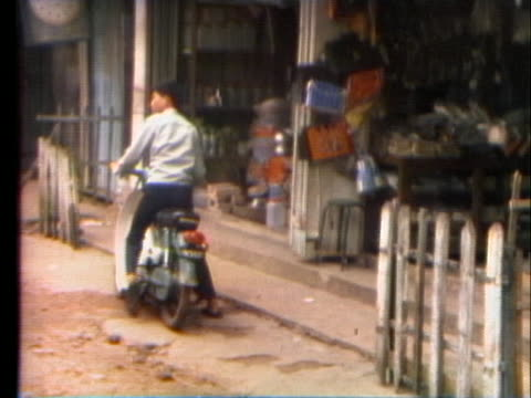 south vietnamese villagers return to their homes destroyed by the vietcong in vietnam. - south vietnam stock videos & royalty-free footage