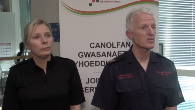 south wales police assistant chief constable jenny gilmer and south wales fire and rescue service's area manager ian greenman speak after storm... - south wales stock videos & royalty-free footage