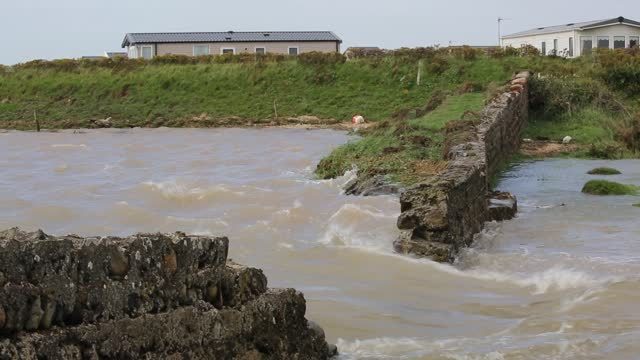 south walney cut off by storm surge flooding, walney island, cumbria, uk. - tide stock videos & royalty-free footage