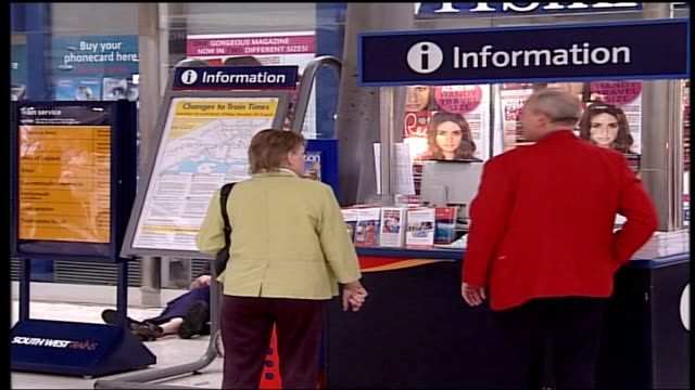 disruption anticipated england london int message about planned south west trains industrial action on passenger display screen passenger looking at... - strike industrial action stock videos & royalty-free footage