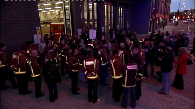 sheffield dusk high angle view and general view of striking firefighters gathered outside fire station on picket line - sheffield stock videos and b-roll footage