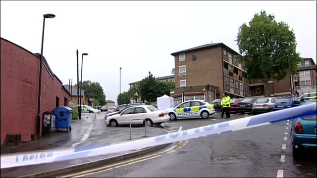 sheffield ext police car and police officers on street behind police tape at cordoned off area where 17 year old tarek chaiboub shot dead forensic... - south yorkshire stock videos and b-roll footage