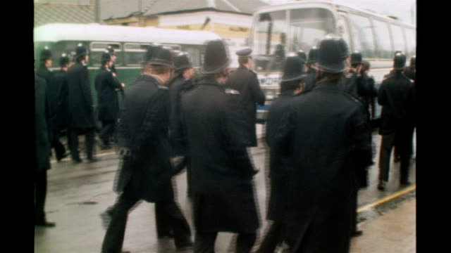 ext police officers arriving at scene of anti national front demonstration police scuffling with protesters - national front stock videos & royalty-free footage