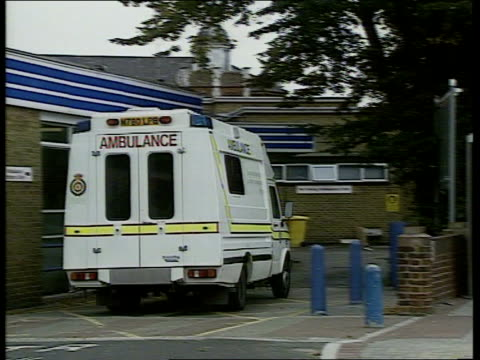 england london ealing hospital ambulance roaring up to hospital entrance sot doctors awaiting injured train passengers at entrance to hospital... - train crash stock videos and b-roll footage