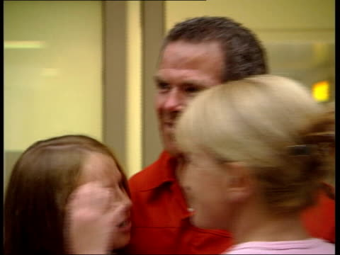 southampton int rowers along into airport lounge where they are reunited with their families after being rescued in the atlantic when their boat pink... - after life stock videos & royalty-free footage
