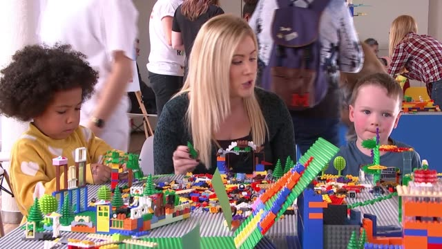 southbank centre workshop challenges children to build ecofriendly cities out of lego england london city of london the gherkin int tilt down lego... - building activity stock videos & royalty-free footage