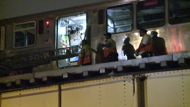 southbound red line train derailed near the station causing power to be cut off and suspending all train service. the fire department was called to... - south america video stock e b–roll