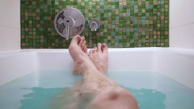 southeast asian people taking bubble bath for relaxing and cleaning his body in the bathroom - bubble bath stock videos & royalty-free footage