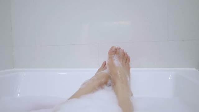 southeast asian people taking bubble bath for relaxing and cleaning his body in the bathroom - bathtub stock videos & royalty-free footage