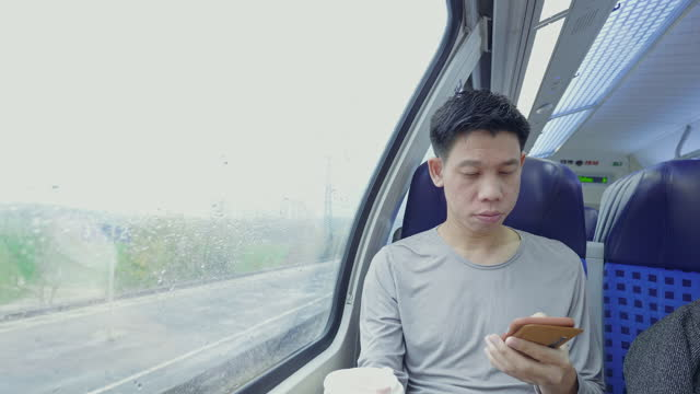 southeast asian traveler on the train with reusable coffee cup - coffee cup stock videos & royalty-free footage