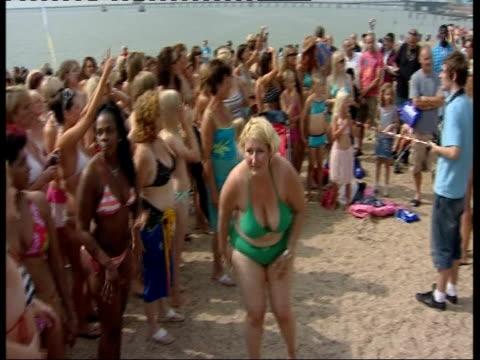 Bikini world record attempt Crowd of women all wearing bikinis gathered on beach for attempt at world bikini record