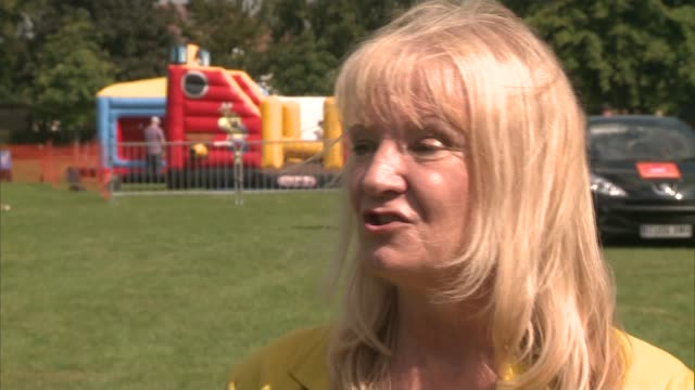 southend carnival to crown a carnival queen for the last time ann holland interview sot cutaway reporter closeup children's shoes general view... - bandstand stock videos and b-roll footage