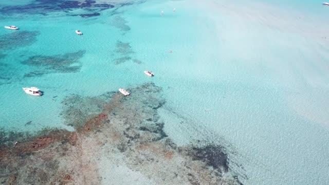 southern corsica island, turquoise sea bay with boats and coastline. france - ピアナ点の映像素材/bロール