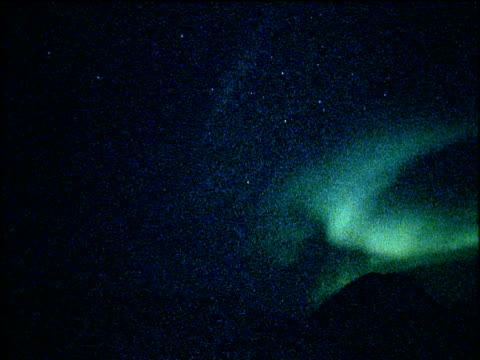 southern lights (aurora australis) streaking across the night sky - aurora australis stock videos & royalty-free footage