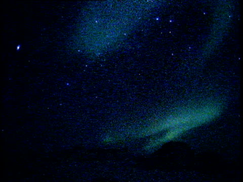 southern lights swirling over mountainous landscape - antarctica night stock videos & royalty-free footage