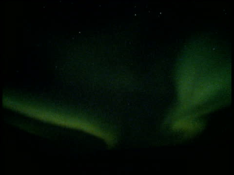 southern lights (aurora australis) twist and flash in vibrant green light across the night sky - aurora australis stock videos & royalty-free footage
