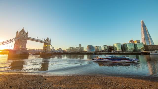 T/L Southwark Bank and Tower Bridge at sunrise