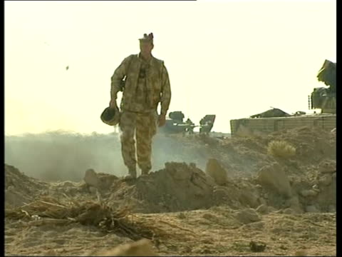 southwest baghdad camp dogwood black watch soldiers burning rubbish before they leave camp dogwood for return to basra la armoured vehicle seen... - conflittualità video stock e b–roll