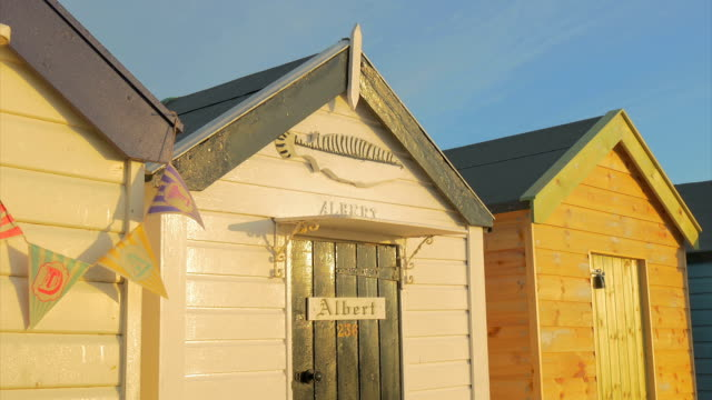southwold,colourful beach hut albert,cu - name tag stock videos and b-roll footage