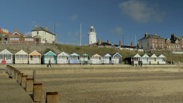southwold,colourful beach huts,people walking on promenade,,lighthouse,ms, - promenade stock videos & royalty-free footage
