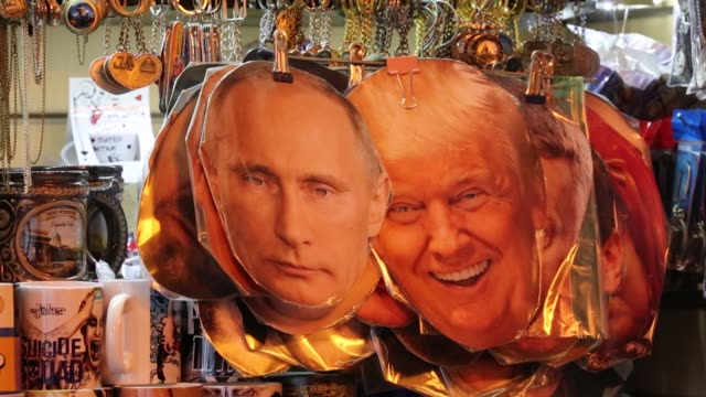 souvenir masks depicting vladimir putin russia's president and donald trump us president sit on display at a tourist stall in the city center ahead... - souvenir stock videos and b-roll footage