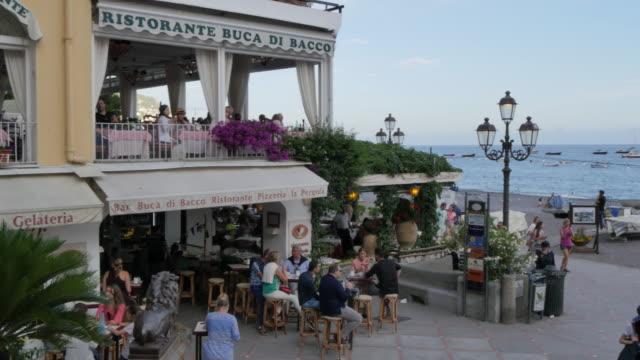 souvenir shops and restaurants, costiera amalfitana (amalfi coast), unesco world heritage site, province of salerno, campania, italy, europe - western script stock videos & royalty-free footage