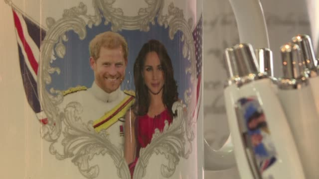 souvenir shops in windsor are already stocked up with memorabilia of prince harry and his fiancee meghan markle ahead of the wedding of the happy... - souvenir stock videos and b-roll footage