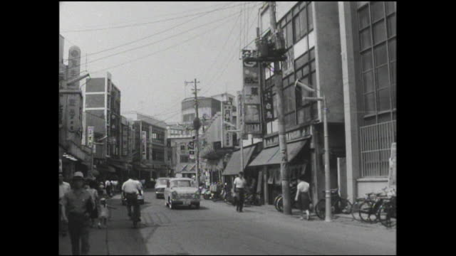 stockvideo's en b-roll-footage met souvenir shops line main street in downtown odawara city. - 1963