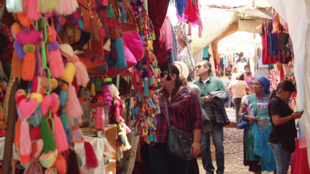 souvenir stores at a traditional market in downtown san cristobal de las casas, chiapas, mexico - craft product stock videos & royalty-free footage