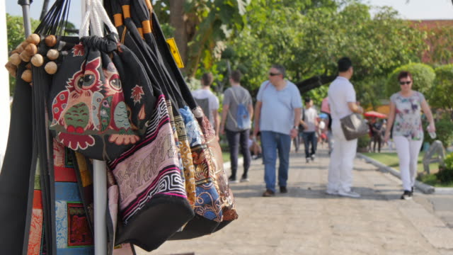 souvenirs and people near riverside temple of wat arun (temple of dawn), bangkok, thailand, southeast asia, asia - souvenir stock videos and b-roll footage