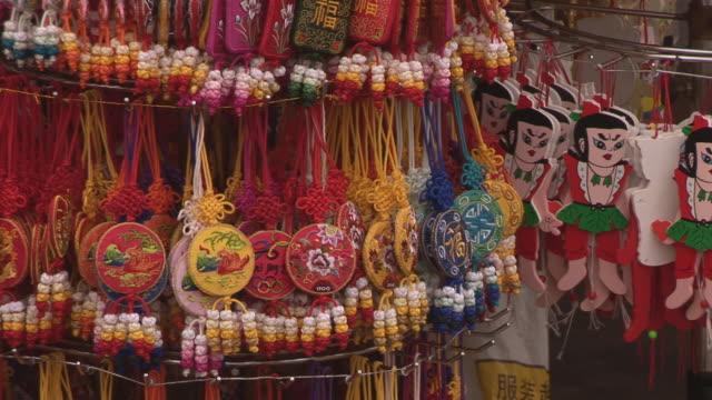 cu souvenirs for sale at tiananmen square/ shanghai, china - 雑貨点の映像素材/bロール
