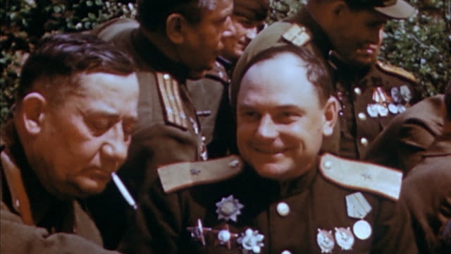 soviet army generals hosting a party for u.s. army generals in honor of first american-russian meeting / torgau, germany - soviet military stock videos & royalty-free footage