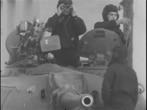 of soviet army members atop a soviet tank during a standoff with u.s. tanks, soviet army members stand atop a soviet tank near checkpoint charlie on... - soviet military stock videos & royalty-free footage