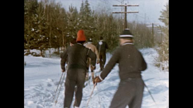 Soviet astronauts Alexei Leonov and Pavel Belyayev cross country skiing