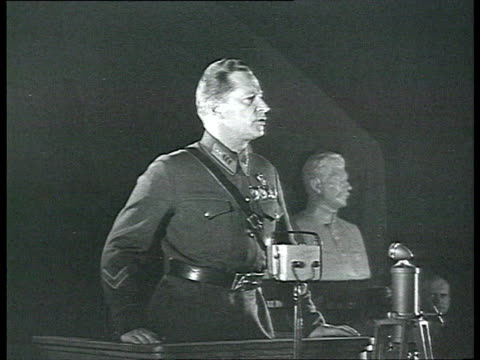 soviet aviator mikhail gromov speaking from platform, busts of stalin and lenin in background / russia /audio - male likeness stock videos & royalty-free footage