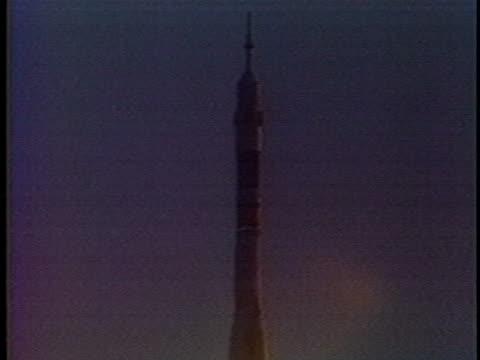 soviet cosmonauts aleksandr viktorenko, aleksandr aleksandrov and syrian mohammed faris wave; their manned spacecraft takes off. - kazakhstan stock videos & royalty-free footage