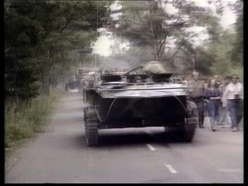 internal:; b)nat ussr: estonia: tallinn: ext bv soviet soldiers as military lorry past l-r bv soldiers standing by tv tower tilt up cms soviet... - tidigare sovjetunionen bildbanksvideor och videomaterial från bakom kulisserna