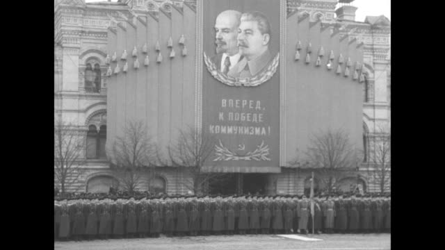 soviet defense minister nikolai bulganin delivers a speech on the 37th anniversary of the october revolution from reviewing stand atop lenin's tomb /... - revolution stock videos & royalty-free footage