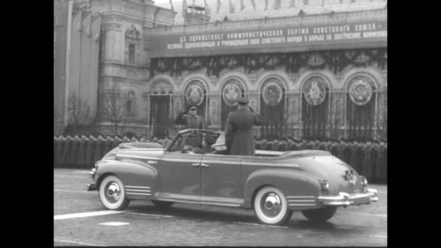 soviet defense minister nikolai bulganin reviews the troops in an open convertible / military parade / bulganin speaks to and is saluted by a soviet... - soviet military stock videos & royalty-free footage