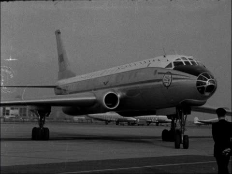 soviet delegates arrive to meet ministry of transport and civil aviation england london london airport ext various as tupolev tu104 plane taxis /... - 1959 stock videos & royalty-free footage