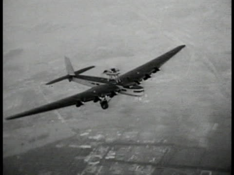 soviet eightengine airplane tupolev ant20 propaganda airplane in flight - 1935 stock videos and b-roll footage