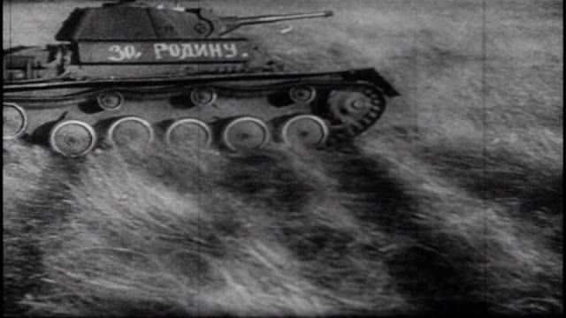 stockvideo's en b-roll-footage met soviet engineers clear obstacles for the army soviet forces advance on german forces tanks rolling over the steppe 1983 soviet film commemorating the... - veldslag