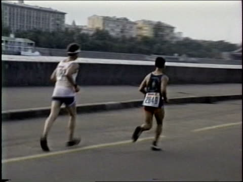 Soviet era footage in Moscow of Footrace and spectators circa late 1980's