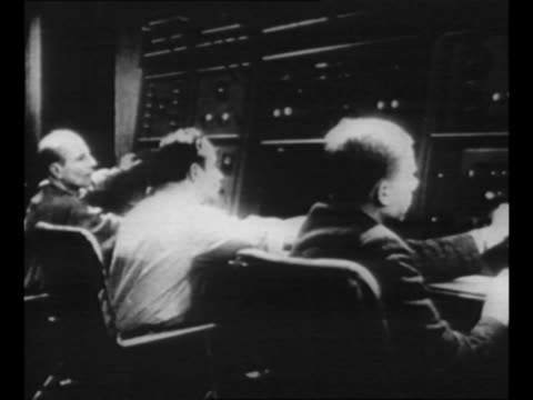soviet film throughout: montage soviet workers in control room / hands turn dial / night: sputnik satellite and attached rocket take off successfully... - space exploration stock videos & royalty-free footage