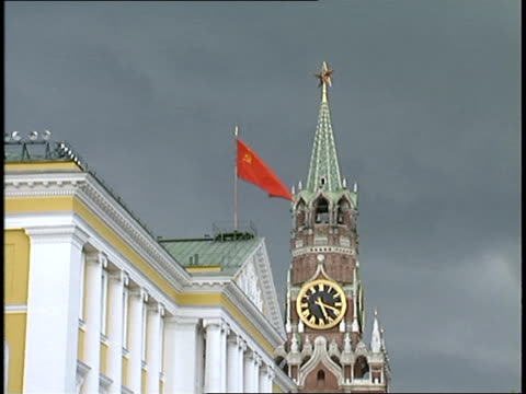 soviet flag waving and clock tower in moscow - former ussr flag stock videos & royalty-free footage
