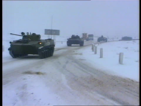 armenian/azerbaijani border lorries along in snow tanks on manoeuvre in azerbaijan soviet troops jumping out of truck armenia tanks along in snow... - army stock videos & royalty-free footage