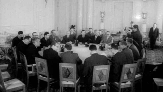 vídeos de stock e filmes b-roll de soviet foreign minister andrei gromyko w averell harriman representing the us and viscount hailsham representing britain and other men seated around... - 1963