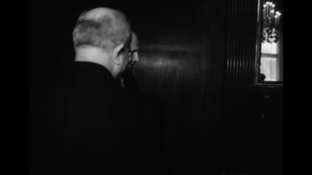 soviet foreign minister vyacheslav molotov and officials entering room molotov shaking hands with officials in room / three shots of molotov sitting... - vyacheslav m. molotov stock videos and b-roll footage