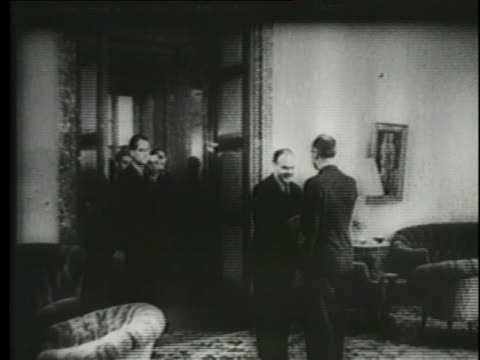 soviet foreign minister vyacheslav molotov signs the treaty of non-aggression with germany as soviet leader joseph stalin looks on. - former soviet union stock videos & royalty-free footage
