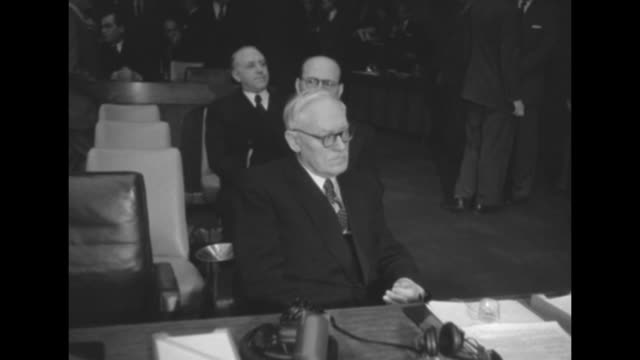 Soviet Foreign Minister/Permanent Representative to the UN Andrey Vyshinsky seated at delegate table with nameplate while being photographed by...